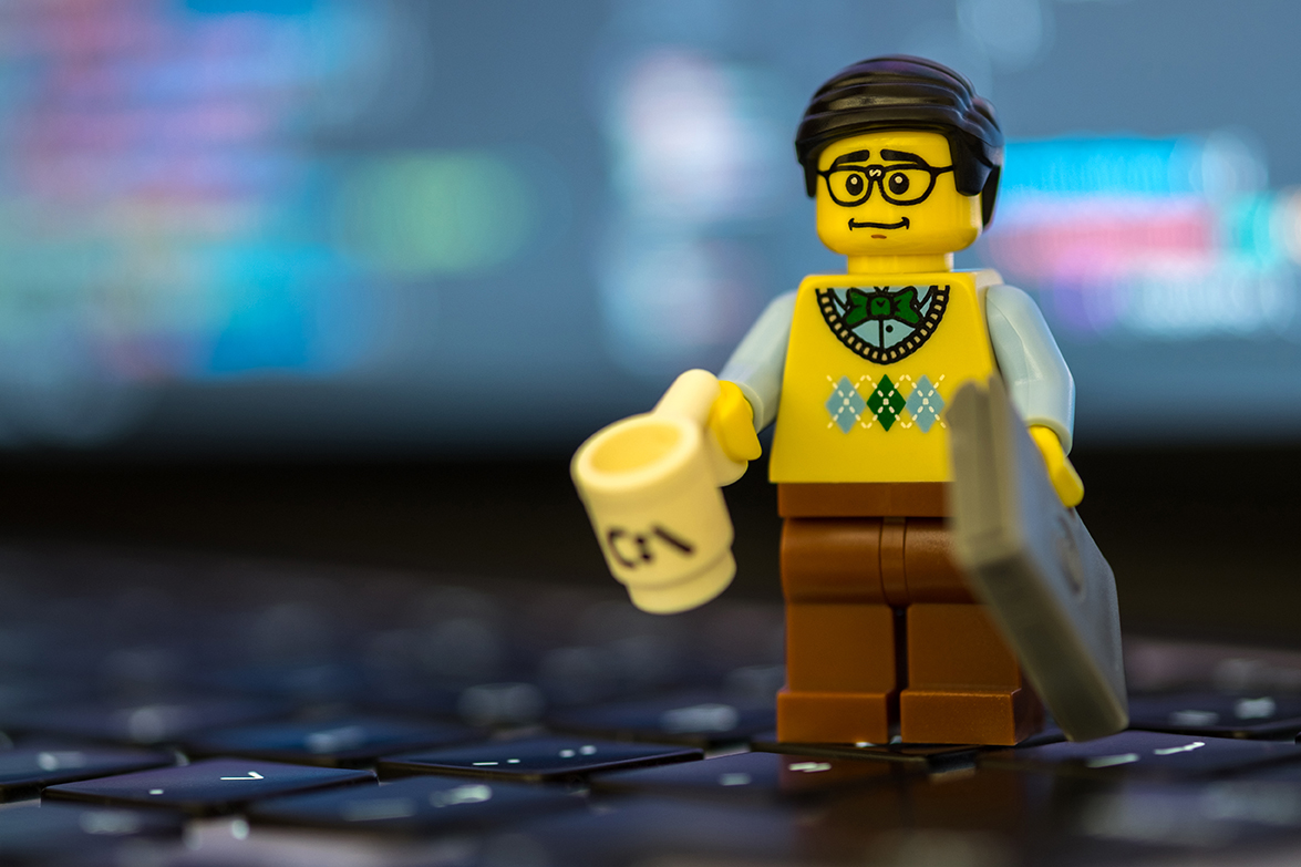 image of lego man holding coffee cup