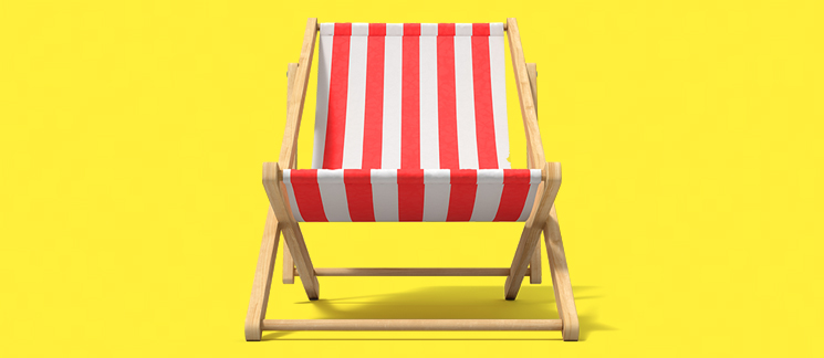 image of classic striped deckchair on yellow background